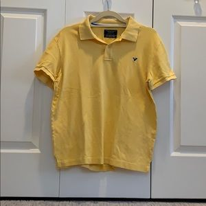 A men's yellow polo from American eagle